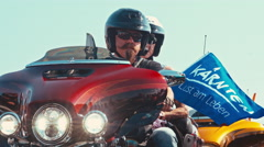 Female and male bikers at a motorcycle parade Stock Footage