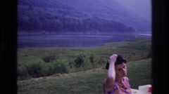 1967: a woman eating at a picnic table with a stunning natural background OTTAWA Stock Footage