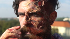 Bearded man with injuries, wounds and blood on the background of the city Stock Footage