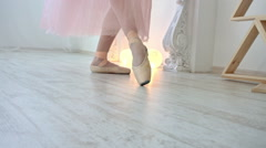 Close up of a ballet dancer's feet. Girl dancing in white room Stock Footage