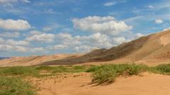 Clouds over the Gobi desert, dune Hongoryn, Mongolia. Full HD Stock Footage