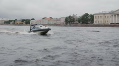 Motor boat passing by the camera. Speed boat in St Petersburg. City architecture Stock Footage