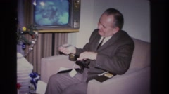 1966: man is happy to put his money in his new pocketbook. HOBOKEN NEW JERSEY Stock Footage