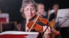 4K Symphony orchestra during a performance with focus on violinist Arkistovideo