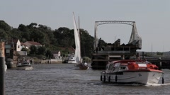 Sailing and motor cruisers pass through Reedham Swing Bridge Stock Footage