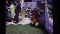 1967: couple meets a man in the back yard. ROCKAWAY BEACH NEW YORK Stock Footage
