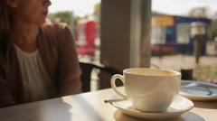 Woman mixing mousse from the coffee and eating it. close up mugs Stock Footage