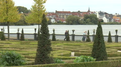 Visitors walking along Promenade by Lake at Frederiksborg Castle Stock Footage