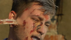 Wounded man removes scars from the face for Halloween Stock Footage