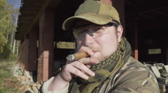 Military smoking a cigar near a building Stock Footage