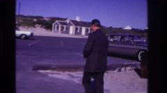 1967: man walking to car ROCKAWAY BEACH NEW YORK Stock Footage