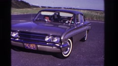 1967: leaving the nature park in a car. ROCKAWAY BEACH NEW YORK Stock Footage