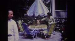 1967: a woman pets her cat. ROCKAWAY BEACH NEW YORK Stock Footage