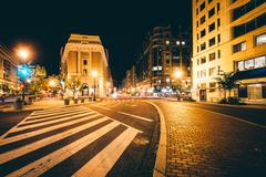 The intersection of H Street and New York Avenue at night, in Washington, DC. Stock Photos