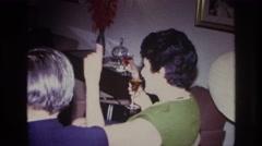 1967: gathering of people in the room enjoying the drinks ROCKAWAY BEACH  Stock Footage