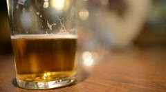 Beer glass in pub Stock Footage