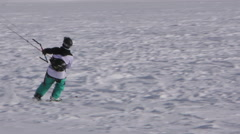 Close up of a snowkiter surfing on a frozen lake in the Switzerland Alps Stock Footage