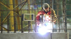 Welder weld reinforcement at the construction site, slow motion Stock Footage
