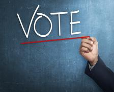 Handwriting Vote with red underline Stock Photos