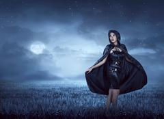Beautiful witch woman with cloak hood Stock Photos