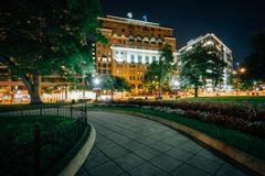 Walkway and buildings at Farragut Square at night, in Washington, DC. Stock Photos