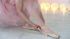 Ballerina wearing her pointe shoes. Stock Footage