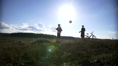 Boy throws the ball to another boy on top of the field Stock Footage