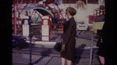 1967: observing the youngsters driving the cars at the amusement park  Stock Footage