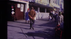1967: man walking on a pleasure pier in the 1950s or 60s. ROCKAWAY BEACH NEW Stock Footage