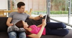 4K Affectionate young couple relaxing at home & shopping online with credit card Stock Footage