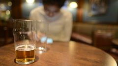 Woman using phone in pub Stock Footage