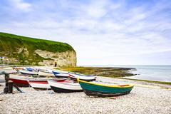 Yport Fecamp village, bay beach, cliff and boats. Normandy, France. Stock Photos