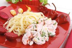 Mediterranean cuisine: rose salmon baked in cream cheese sauce Stock Photos