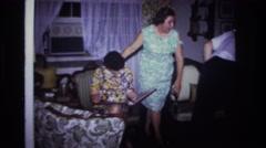 1967: indoor family scene mother seeing child ROCKAWAY BEACH NEW YORK Stock Footage