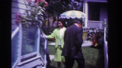 1967: people outside looking at the flowers on the porch. ROCKAWAY BEACH  Stock Footage