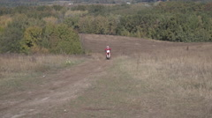 Motocross Racer Rides Past the Camera Slow Motion Stock Footage