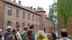 4K Auschwitz Tour Group at Arbeit Macht Frei Gates, Concentration Camp Stock Footage