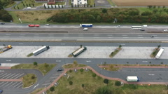 Aerial view highway and rest area Stock Footage