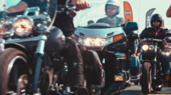 A group of bikers at a motorcycle parade out of focus in the end Stock Footage