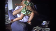 1968: little girl trying to steal dad's wine. OCEAN CITY NEW JERSEY Stock Footage