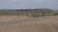 Motocross Riders Riding on the Mountain Stock Footage