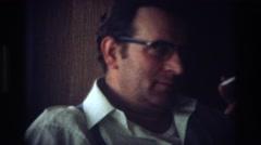 1968: man smoking OCEAN CITY NEW JERSEY Stock Footage