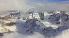 Epic Mountain Peaks Flyover Fast thru Clouds Forward Aerial HD Stock Footage