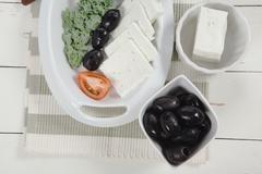 Fresh greek feta cheese sandwich on white plate Stock Photos