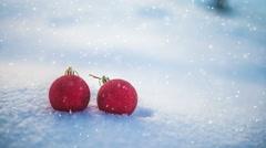 Christmas balls on snow and snowfall seamless loop slowmotion 4k UHD (3840x2160) Stock Footage