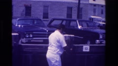 1968: a fat man in white trousers and shirt is collecting some cables OCEAN CITY Stock Footage