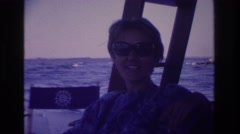 1968: lady riding in a boat smiling and talking. OCEAN CITY NEW JERSEY Stock Footage