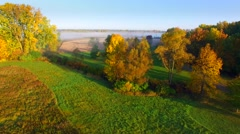 Scenic rural fields and forests veiled in fog on autumn morning. Stock Footage