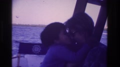 1968: boy licking the nose of his mother sitting on the deck OCEAN CITY  Stock Footage