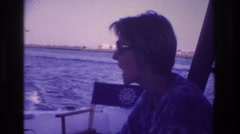 1968: woman with glasses viewing from a boat water waves high OCEAN CITY  Stock Footage